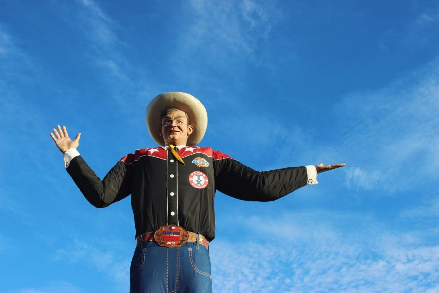 "A Texan Welcome: Big Tex Welcomes Visitors to the State Fair. The iconic cowboy waves an automated hand as he says ""Howdy Folks! Welcome to the State Fair of Texas."""