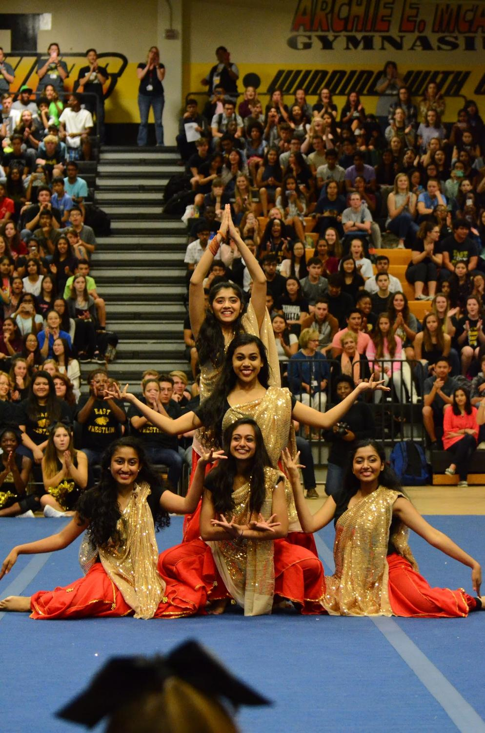 "Performance Rush: Manisha Abraham, Kareena Senghani, Nivetha Murali, Devanshi Parikh, Grace Geevarghese at the end of their first performance during the first pep rally.  After their performance, them members felt a rush of adrenaline and were touched, seeing the school's positive reaction to them.  ""It was scary performing in front of the whole school,"" Manisha said, ""but it was also cool to see everyone cheering for us."""