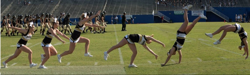Kennedy Kerrigan (12) tumbling across the football field.