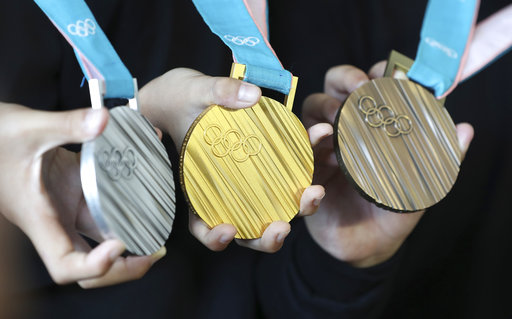 South Korean athletes with their medals during the 2018 Winter Olympics.