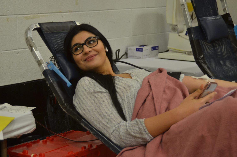 Senior Leena Rammal gives a smile after her donation.