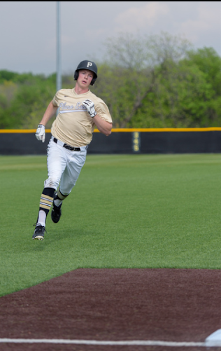 Junior Jonathan Mcnair rounds third base.