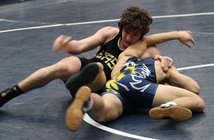 Junior Varsity team wrestles in February tournament.