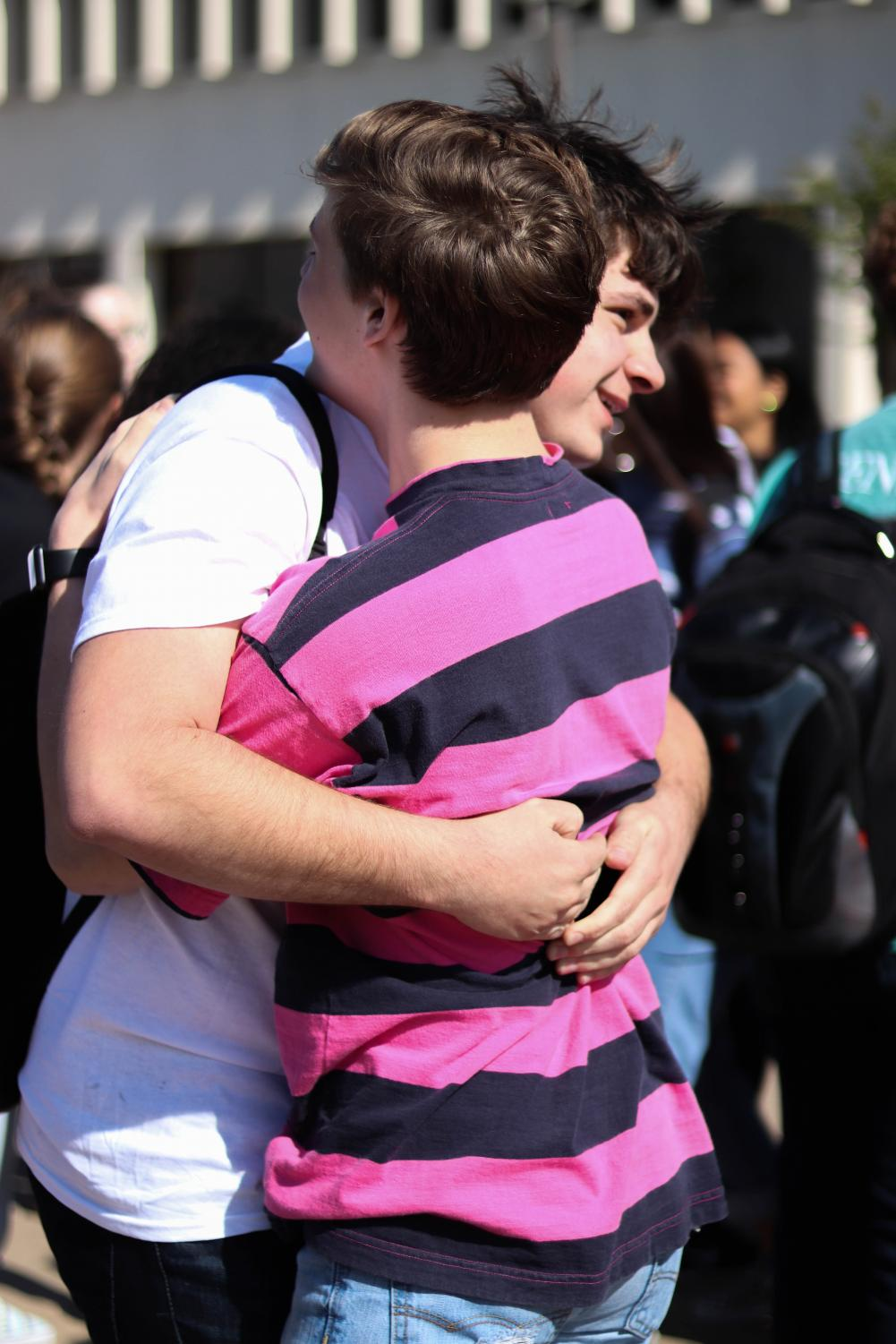 Senior Jacob Browning hugs a friend at the walk out for the Columbine High School Shooting.