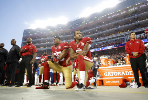 Quarterback Colin Kaepernick (7) and safety Eric Reid (25) kneel during the National Anthem prior to a game against the Los Angeles Rams on Sept. 12.