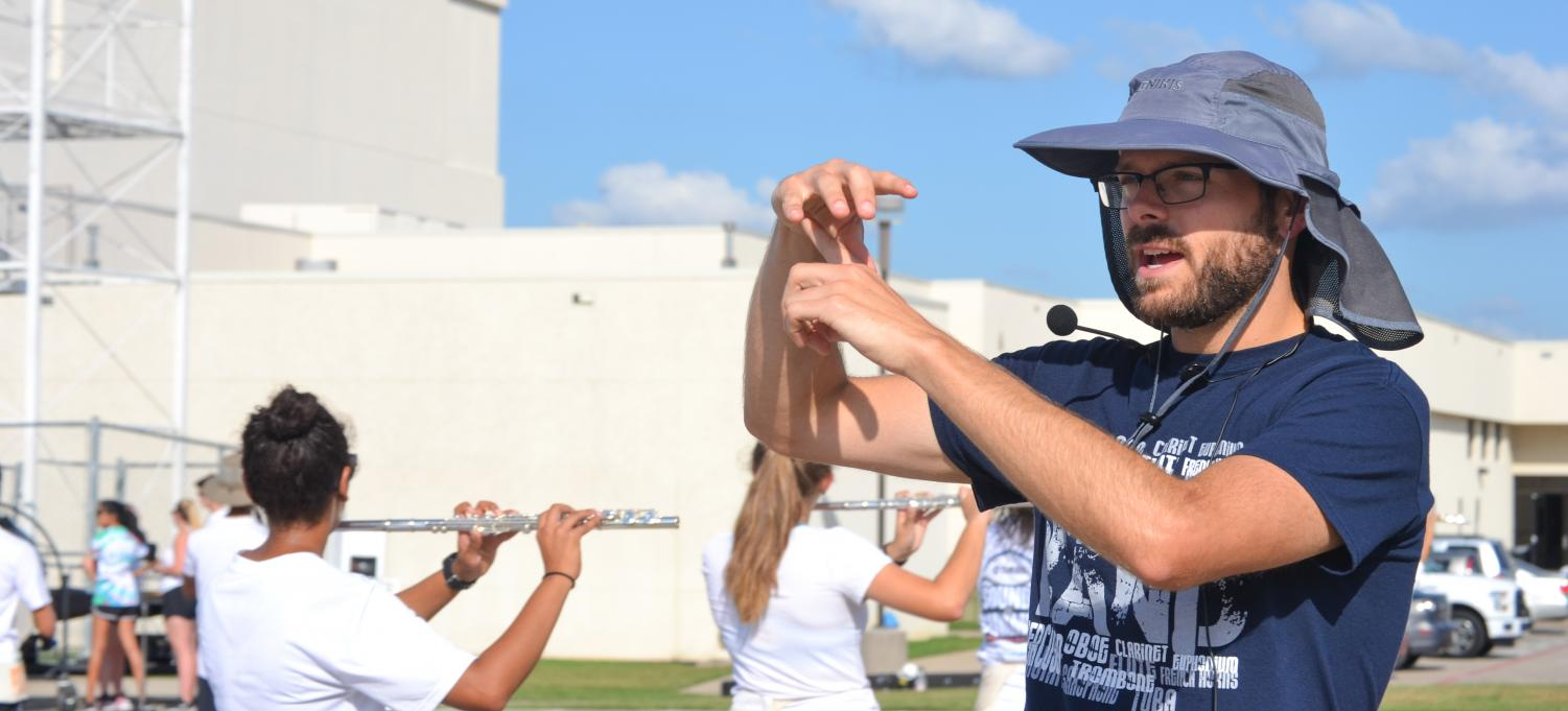 Mr. Albert directs the flutes during marching practice after school on Sept. 13.
