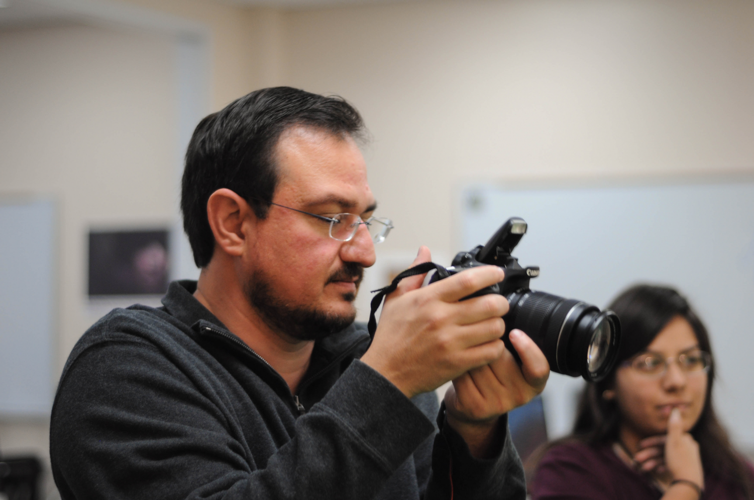 Teacher Jesus-Octavio Oropeza demonstrates taking profile shots to his digital media students.