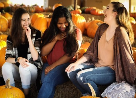 Seniors Sophia Donaghy, Evanna Momtaj and Gabrielle Collins enjoy an Autumn day at the pumpkin patch on Oct. 22, 2017.