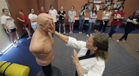 Marilyn Kirby shows young girls self-defense tactics on a dummy target in Plano, Texas on Mar. 26, 2011.