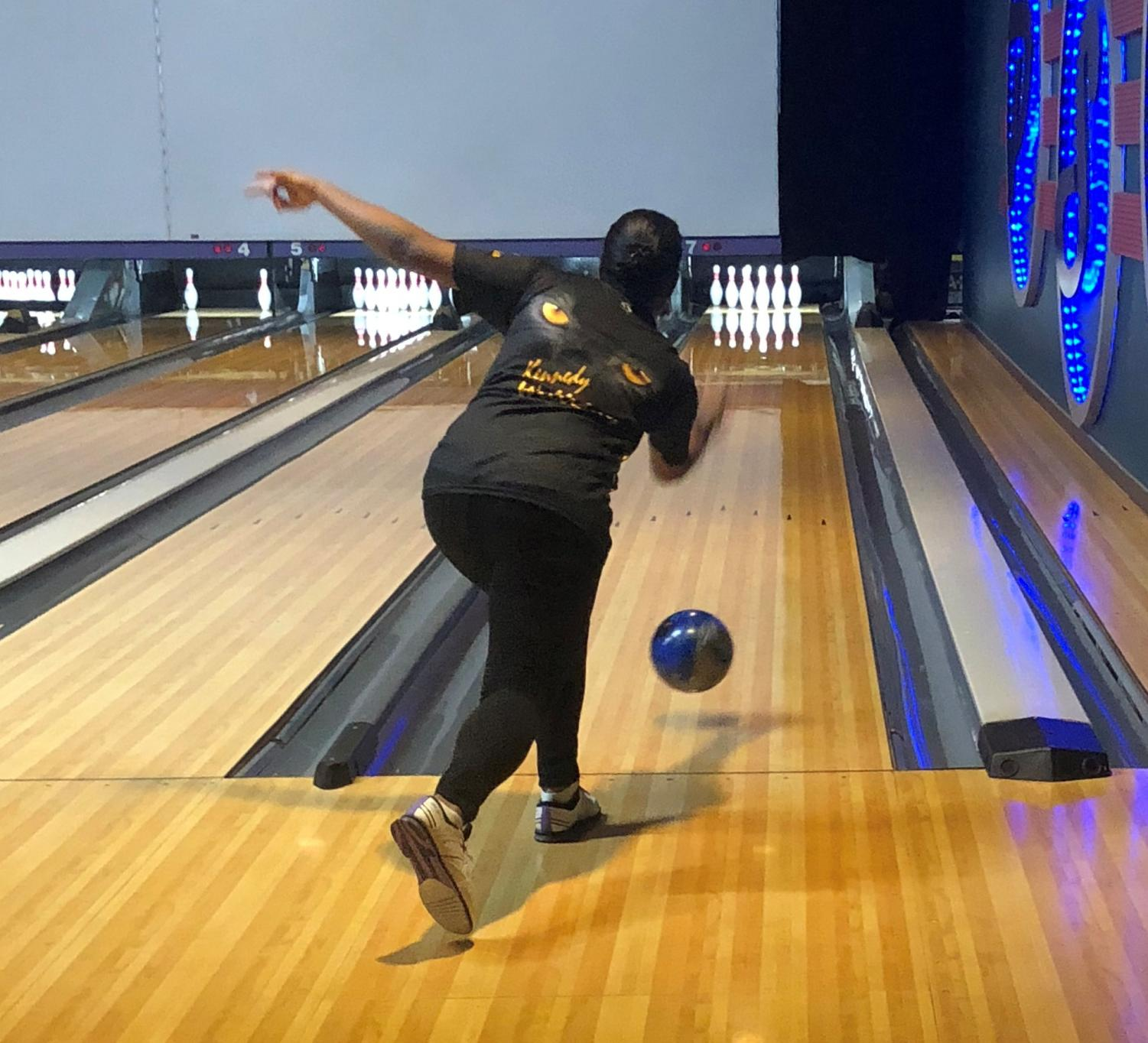 Senior and JV bowler Kennedy Williams launches a ball down the lane at Plano Super Bowl during the Panther Bowlers CARE project on Feb. 18.