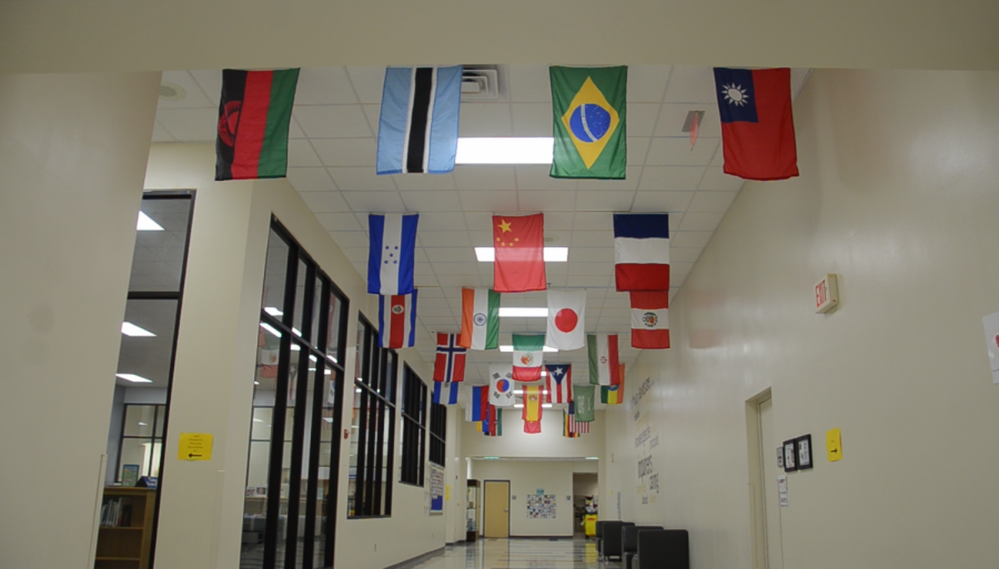 Flags line the ceiling of the Huffman Elementary lobby on April 30.