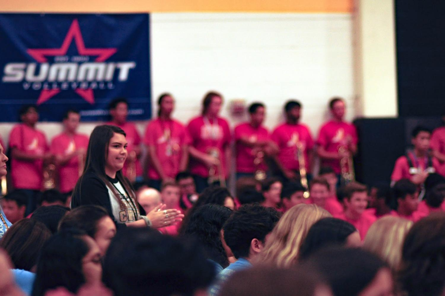 Proud Coach: Rose smiles on Sept. 13 as she watches her new cheer team perform at the pep rally. This was their first performance of the year, so she felt excited to see her cheerleaders show the school what they're capable of.