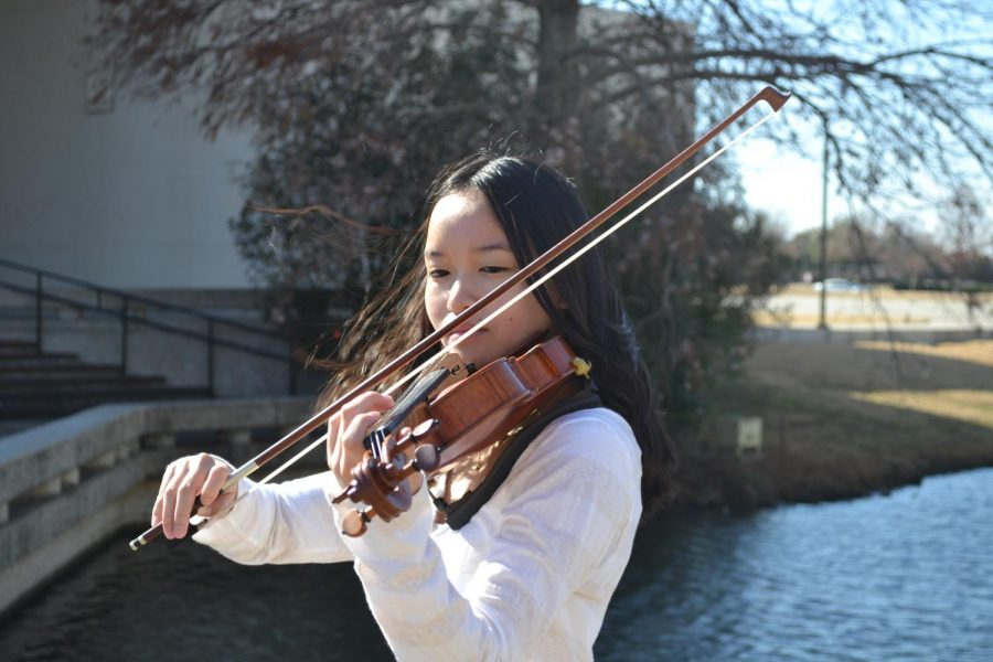 Junior Tiffany Doan practices on her violin. She is one of the four who placed in the top 3% of auditions for Texas Music Educators Association All-State.