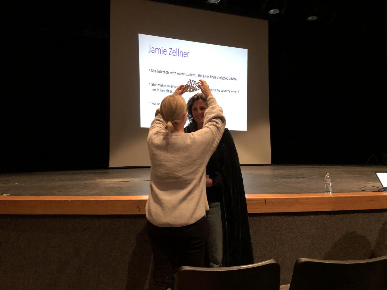 Associate Principal of Curriculum Sheela Daniels crowns ESL teacher Jamie Zellner as Teacher of the Year at a faculty meeting Dec. 10.