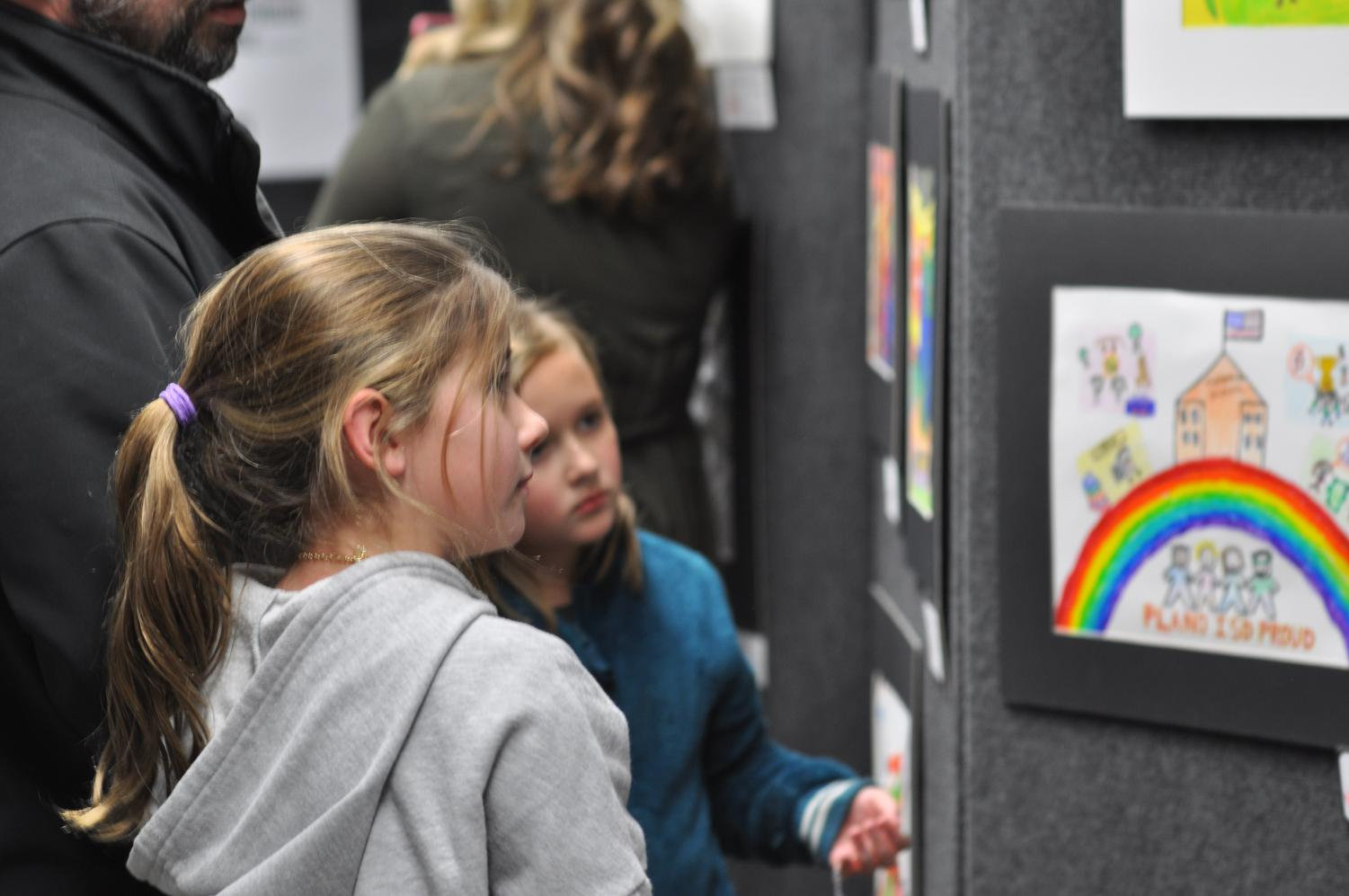 Prideful Pair: Plano ISD students view artwork at the annual Martin Luther King Jr. Tribute Event  Thursday, Jan. 23. The event celebrated the school district's diversity by honoring students' creative talents.