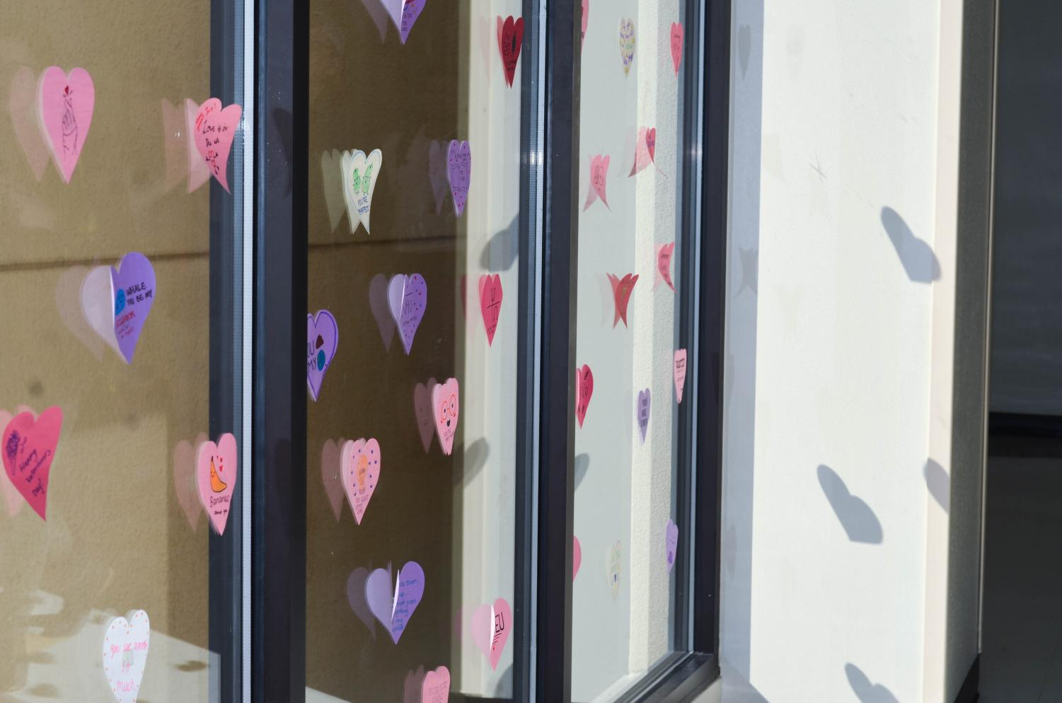 Paper+hearts+cover+the+windows+of+the+building+five+hallway.+NAHS+created+these+Valentine%E2%80%99s+after+school+Feb.+13.