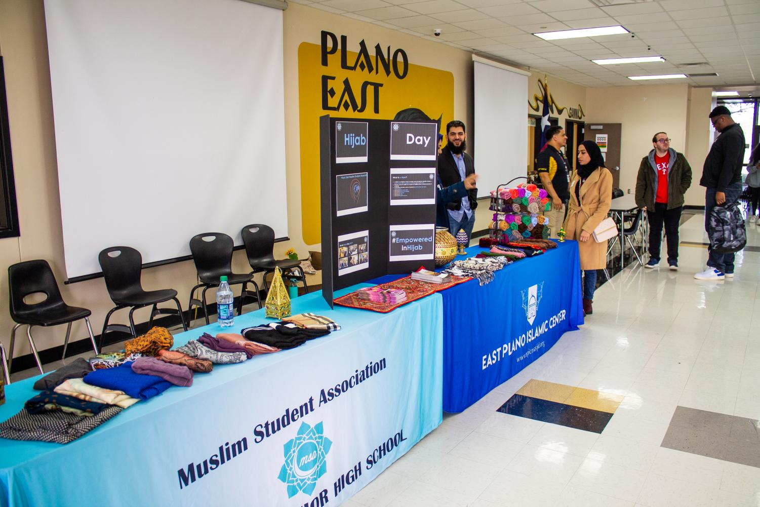 East+Plano+Islamic+Center+%28EPIC%29+volunteers+Nomana+Syed%2C+Ustadh+Morad+Barghouti+and+Sophia+Khan+set+up+a+display+of+headscarves+and+an+informational+tri-fold+board.+Syed%2C+Barghouti+and+Khan+arrived+prior+to+the+start+of+A+lunch+to+set+up+the+display.