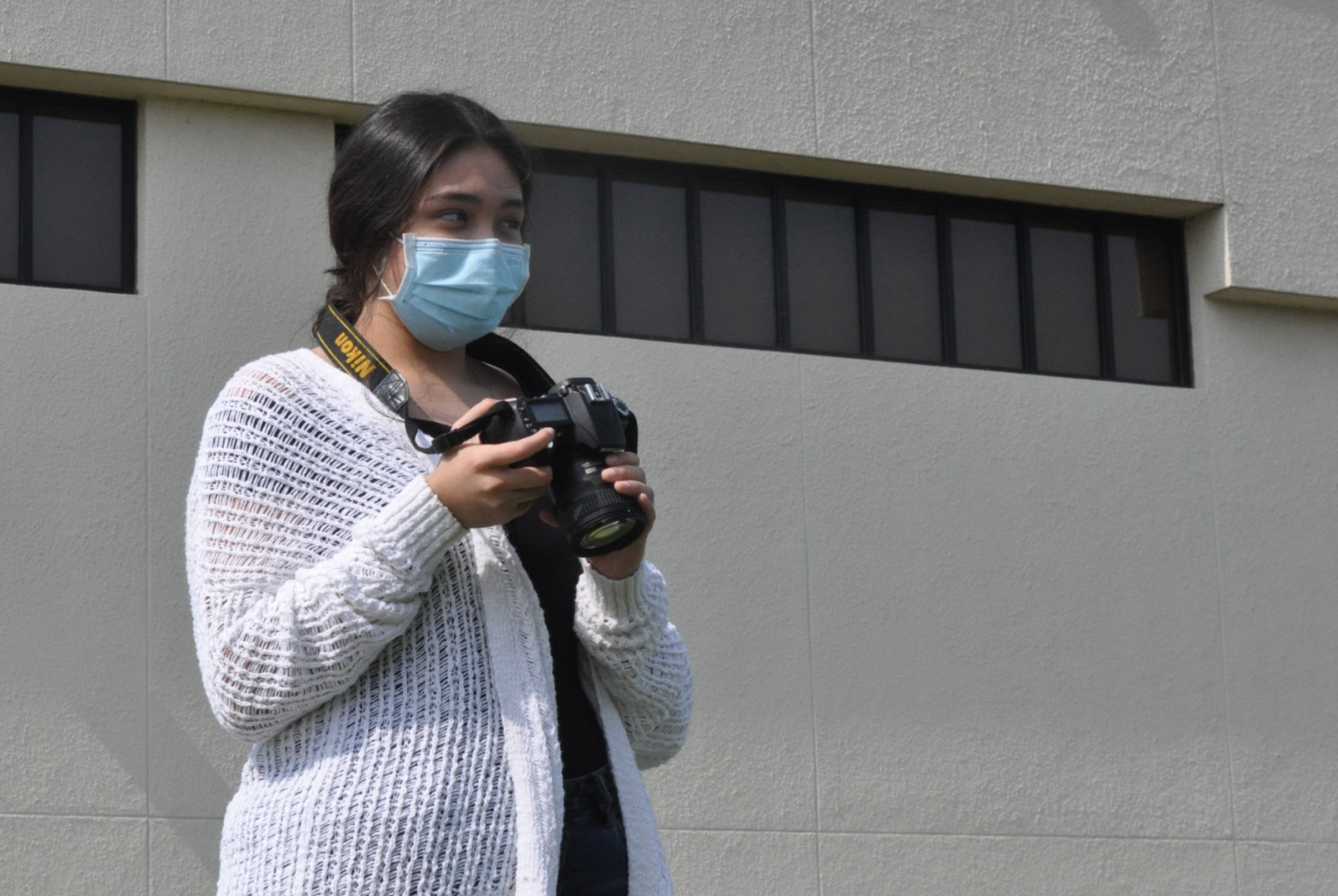 Junior Montserrat Barbosa learns how to take photos with varying angles during 3rd period, Sept. 17.