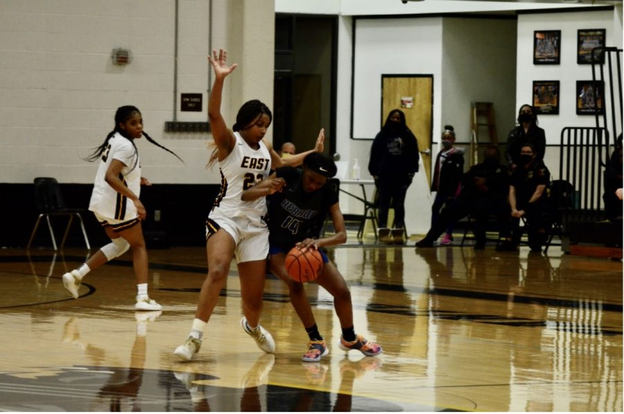 In the game versus Hebron, junior Donavia Hall plays defense while trying to block middle penetration from the other team.
